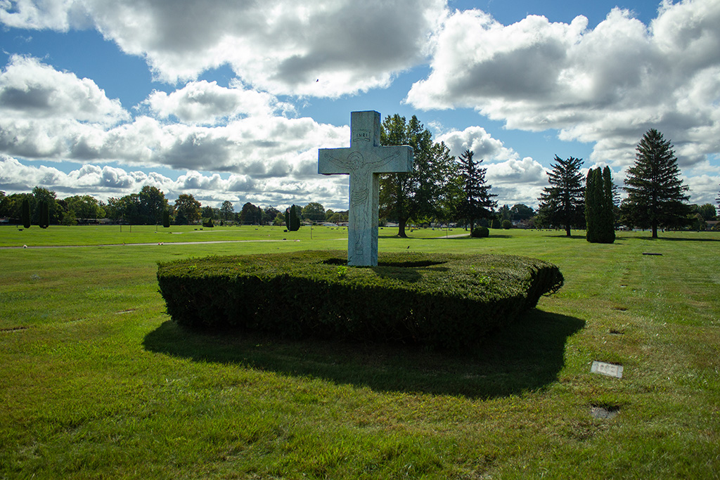 lovely cross statue on grounds of East cemetery