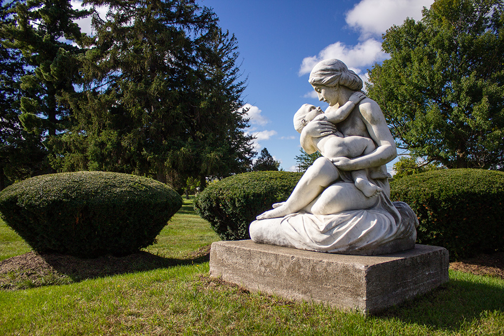 lovely statue of mother and child on grounds of East cemetery